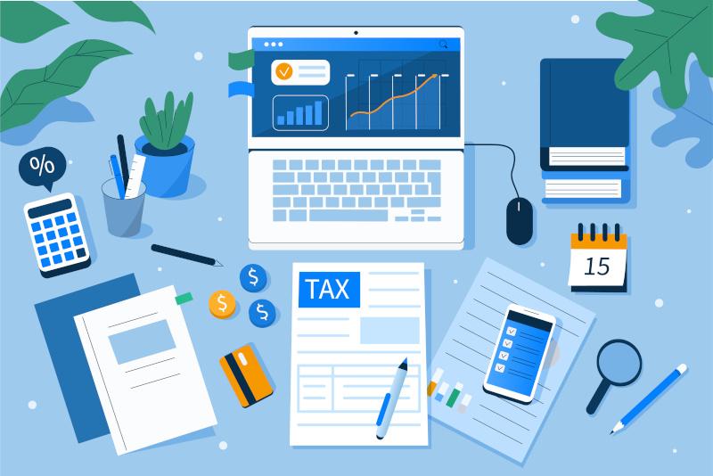税計算用のドキュメントを備えたオフィスデスク、グラフの財務レポート、カレンダーには納税日